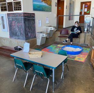 View of small table, sandbox, and chalkboard play area at the museum.